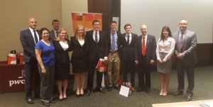 The winning team poses for a group photo with their mentors and PwC professionals.